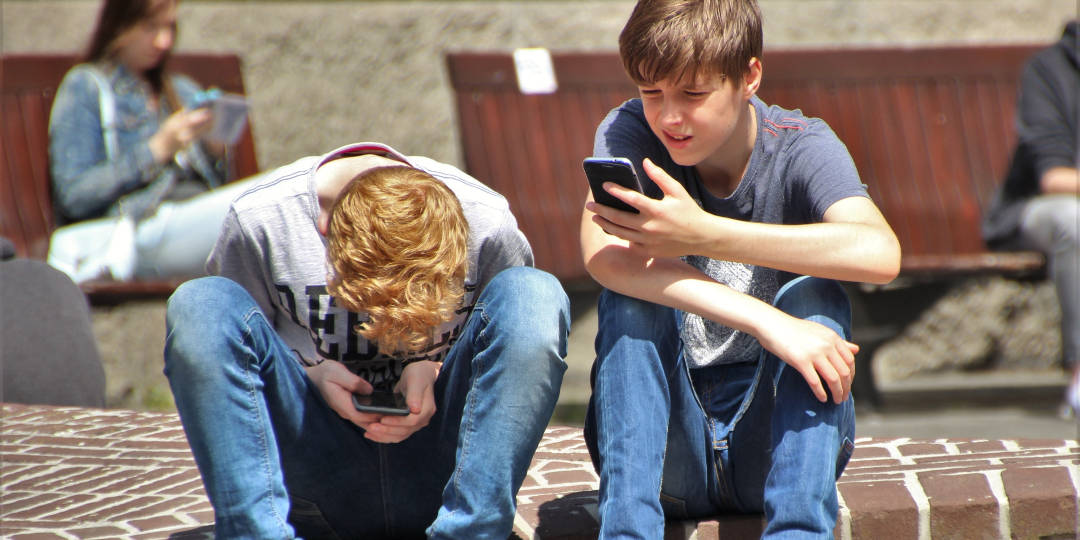 boys on phone - why screen time is bad parenting - Dynamic Dad